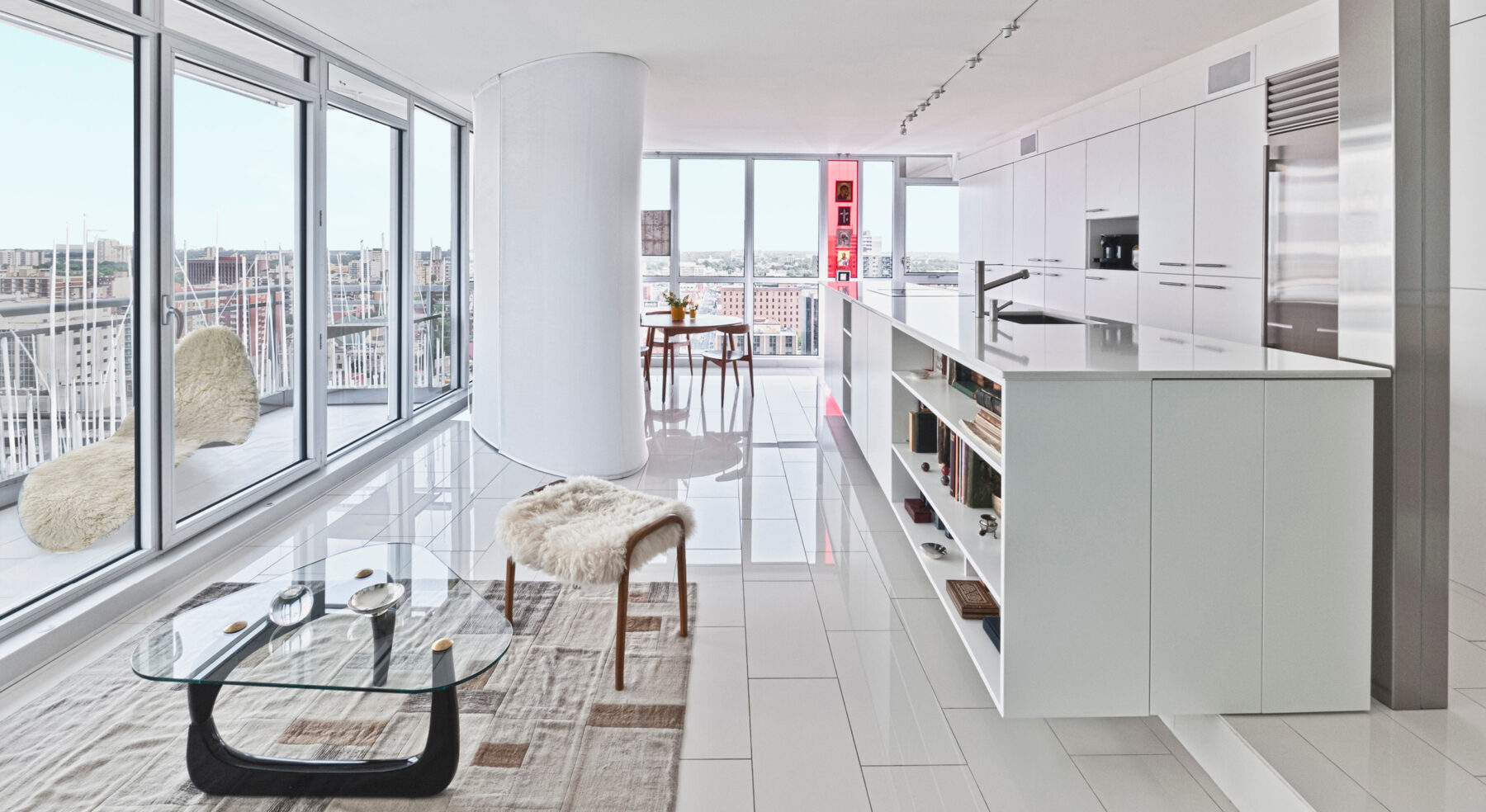 Redeveloper Apartment living area and kitchen with view of balcony