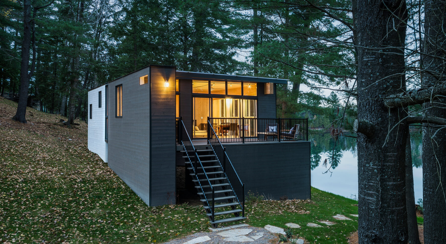 View of CLT Cottage exterior at front entry with view of lake