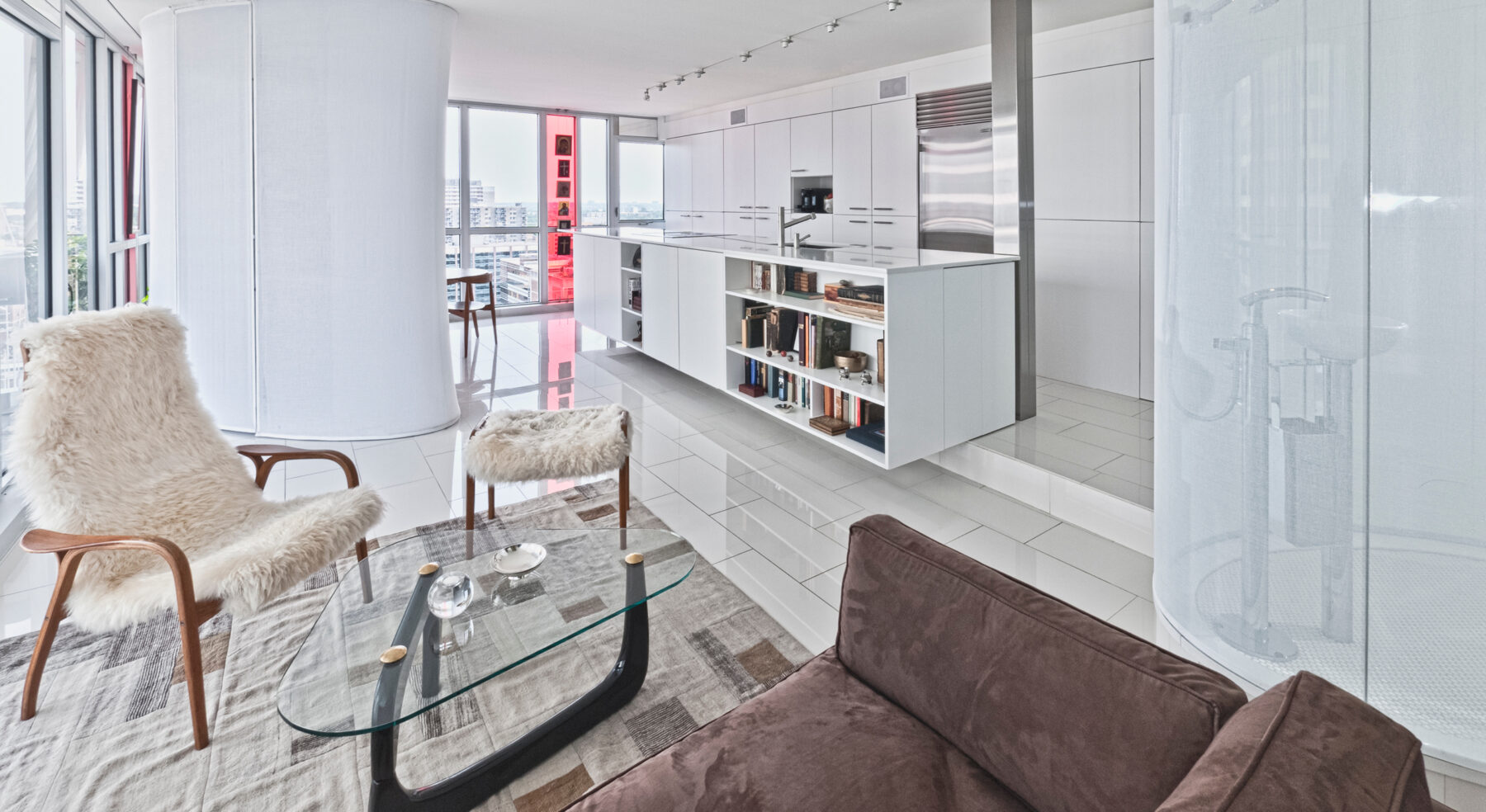 Redeveloper Apartment living area with kitchen in background