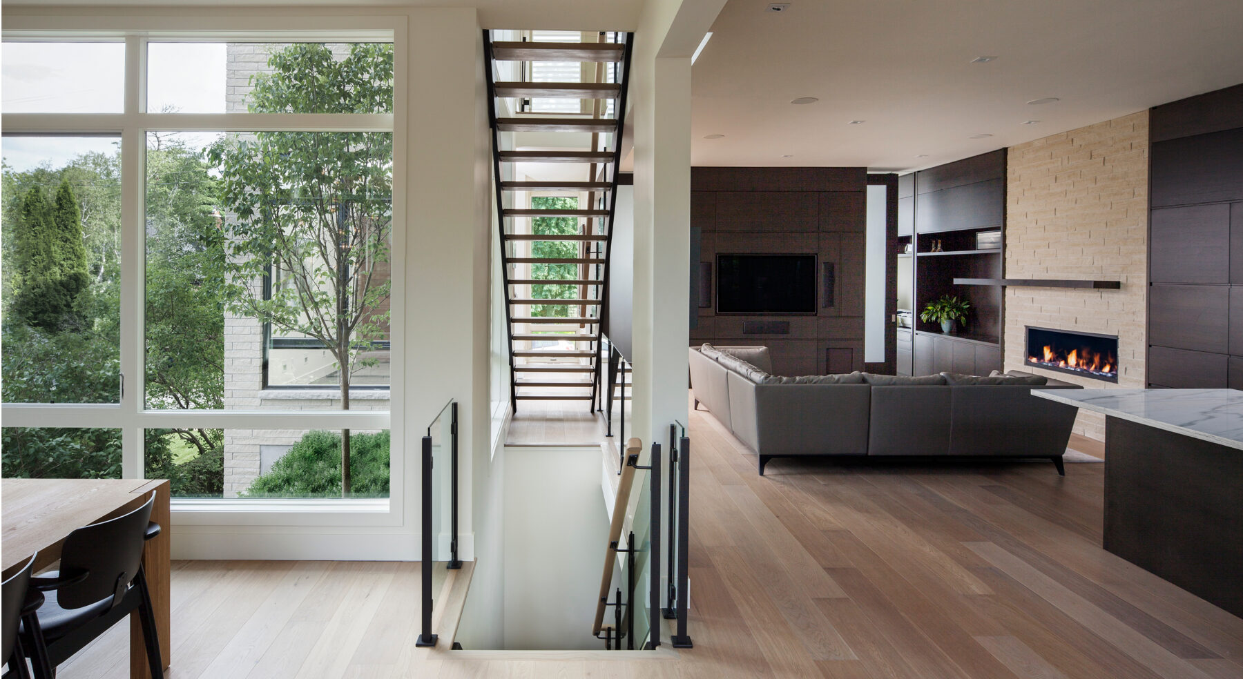 Front-view of Westboro Home stairs and living area