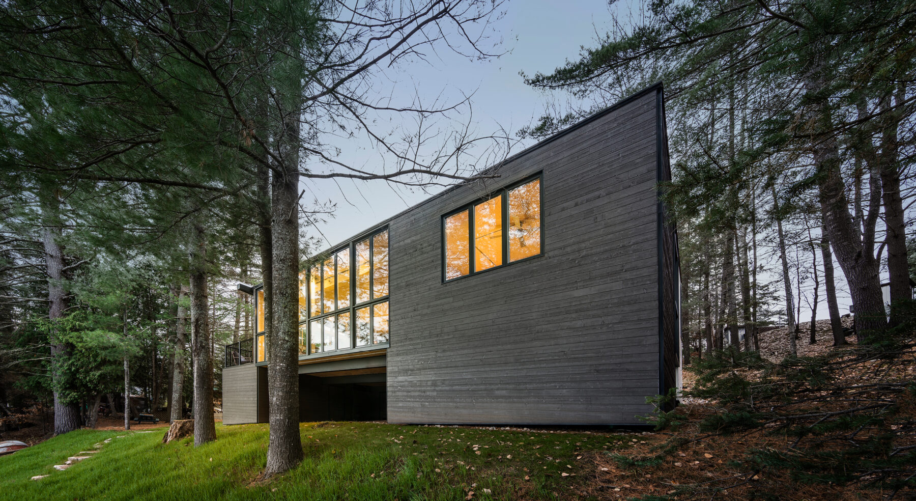 Angled shot of CLT Cottage exterior from lake