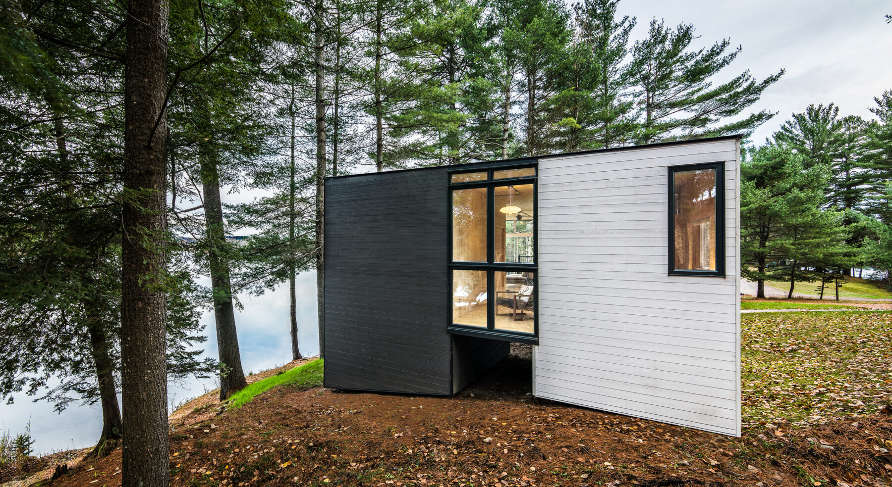 Rear facade of CLT Cottage with view of lake