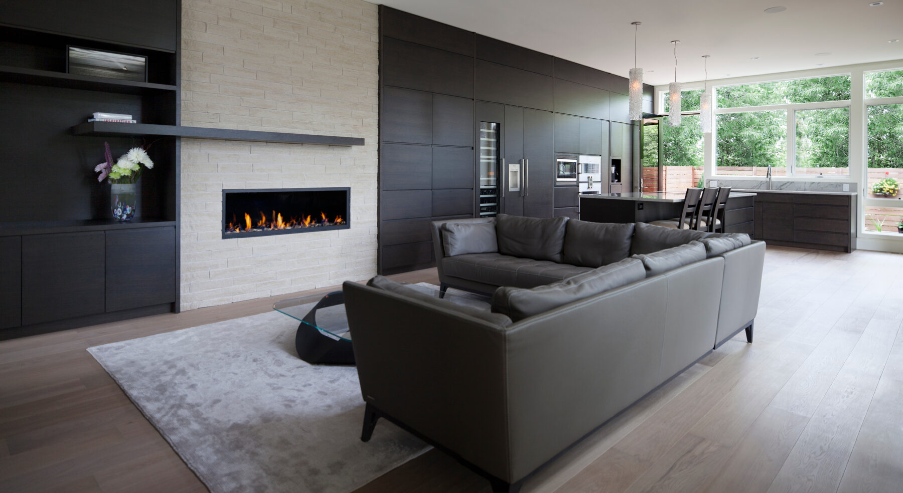 View of Westboro Home living area fire place and kitchen