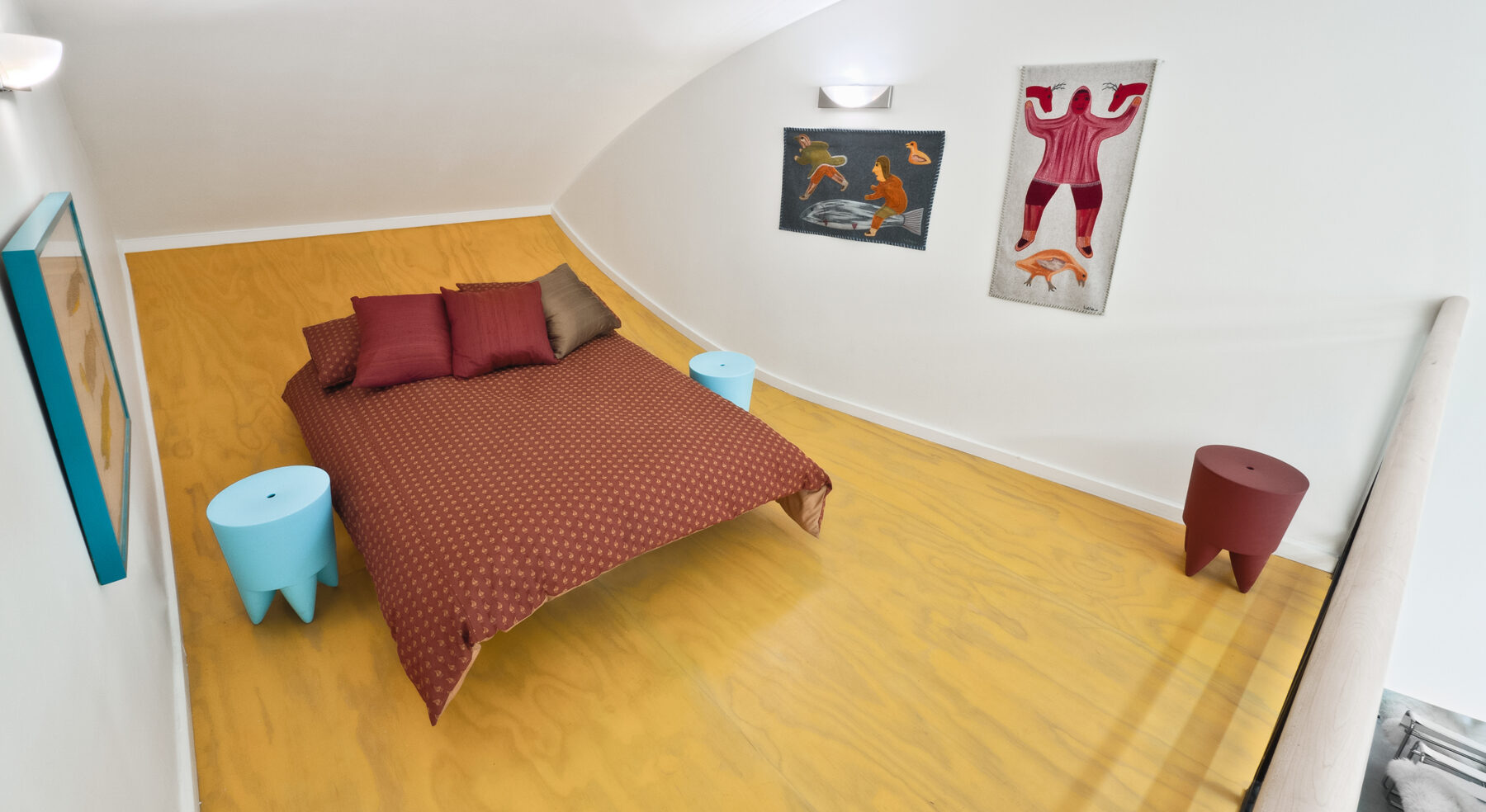 Curved-view of Hill-Maheux Cottage master bedroom loft
